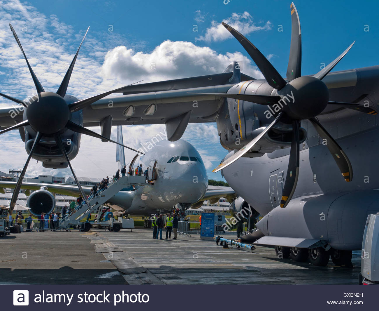 Visitors boarding Airbus A380 Airbus Military A400M USA in forground Farnborough 2012 - Stock Image