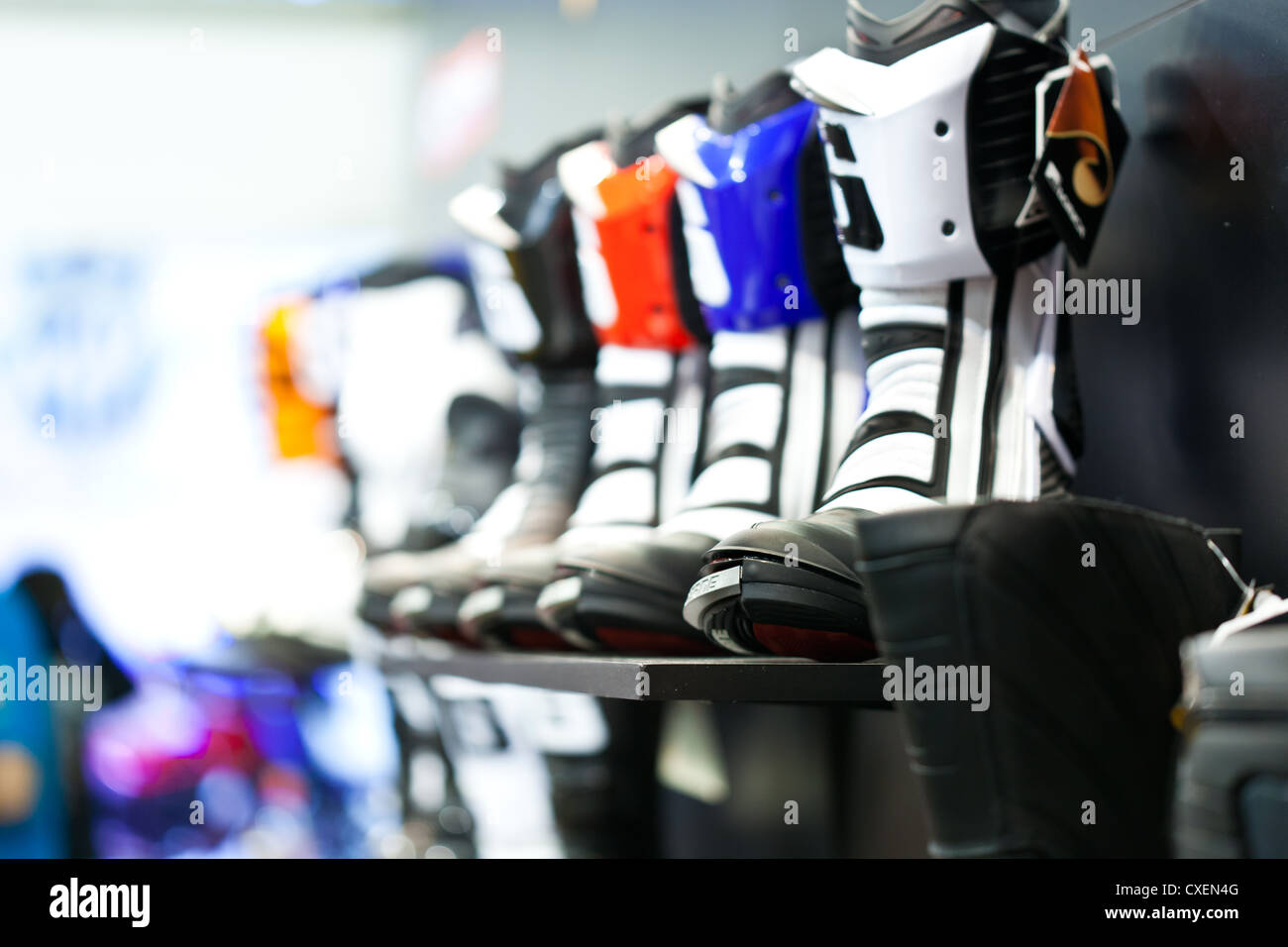 Motorcycle boots in assortment in shop - Stock Image