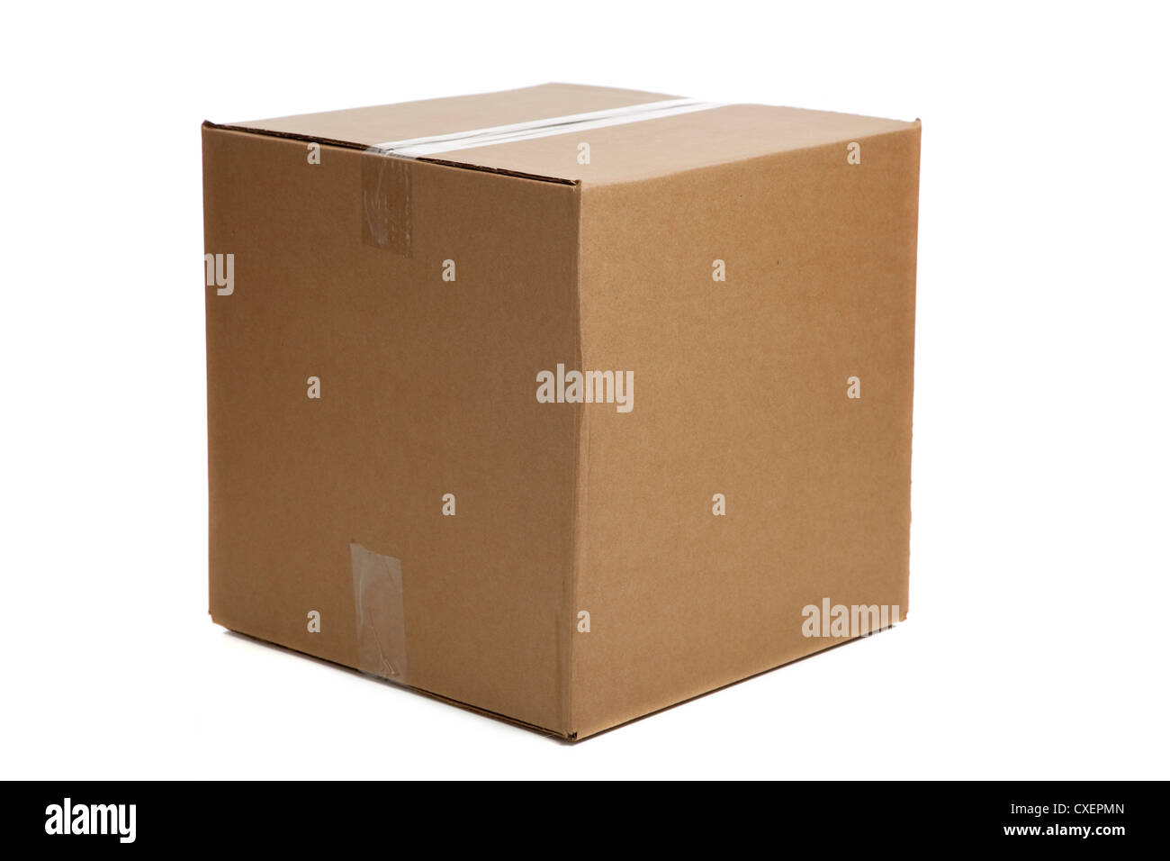 Plain brown corrugated packing box on a white background - Stock Image