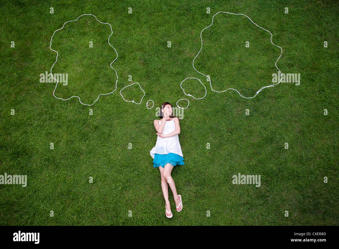 Day dreaming young woman - Stock Image
