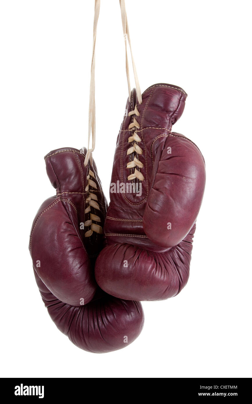 Vintage red leather boxing gloves on a white background - Stock Image