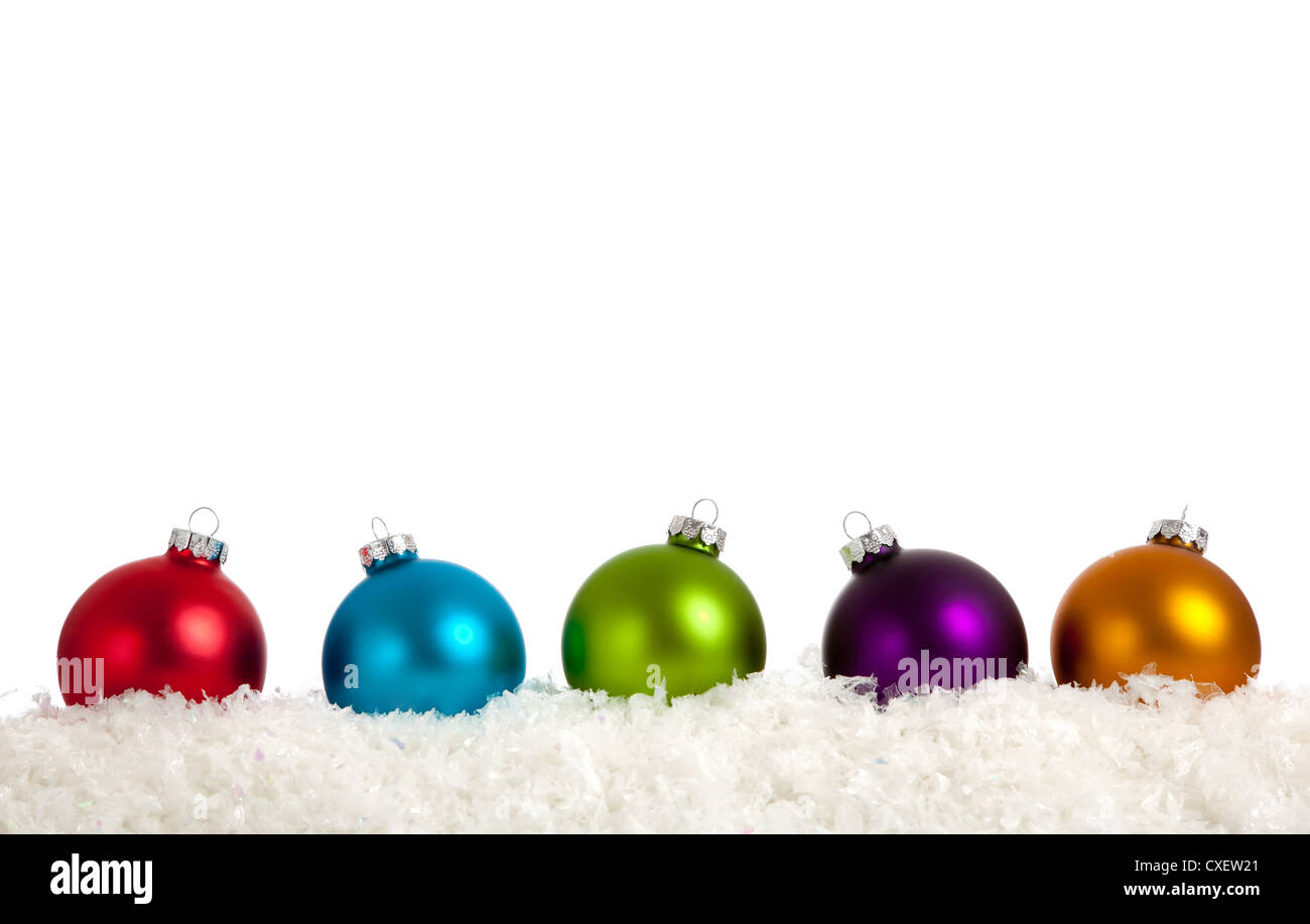 Row of brightly colored Christmas ornaments on a white background ...