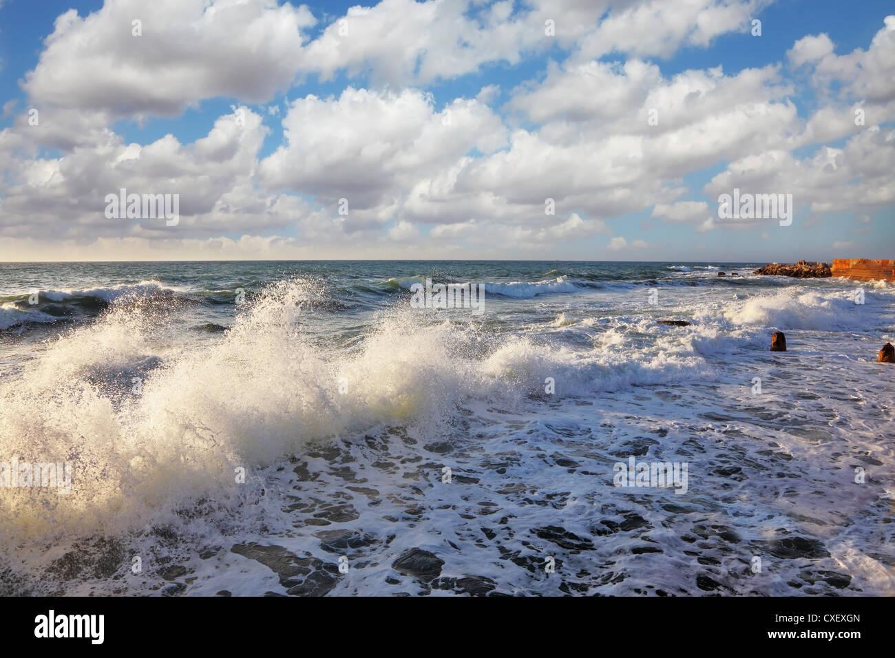 Sea foam shines on the sun Stock Photo