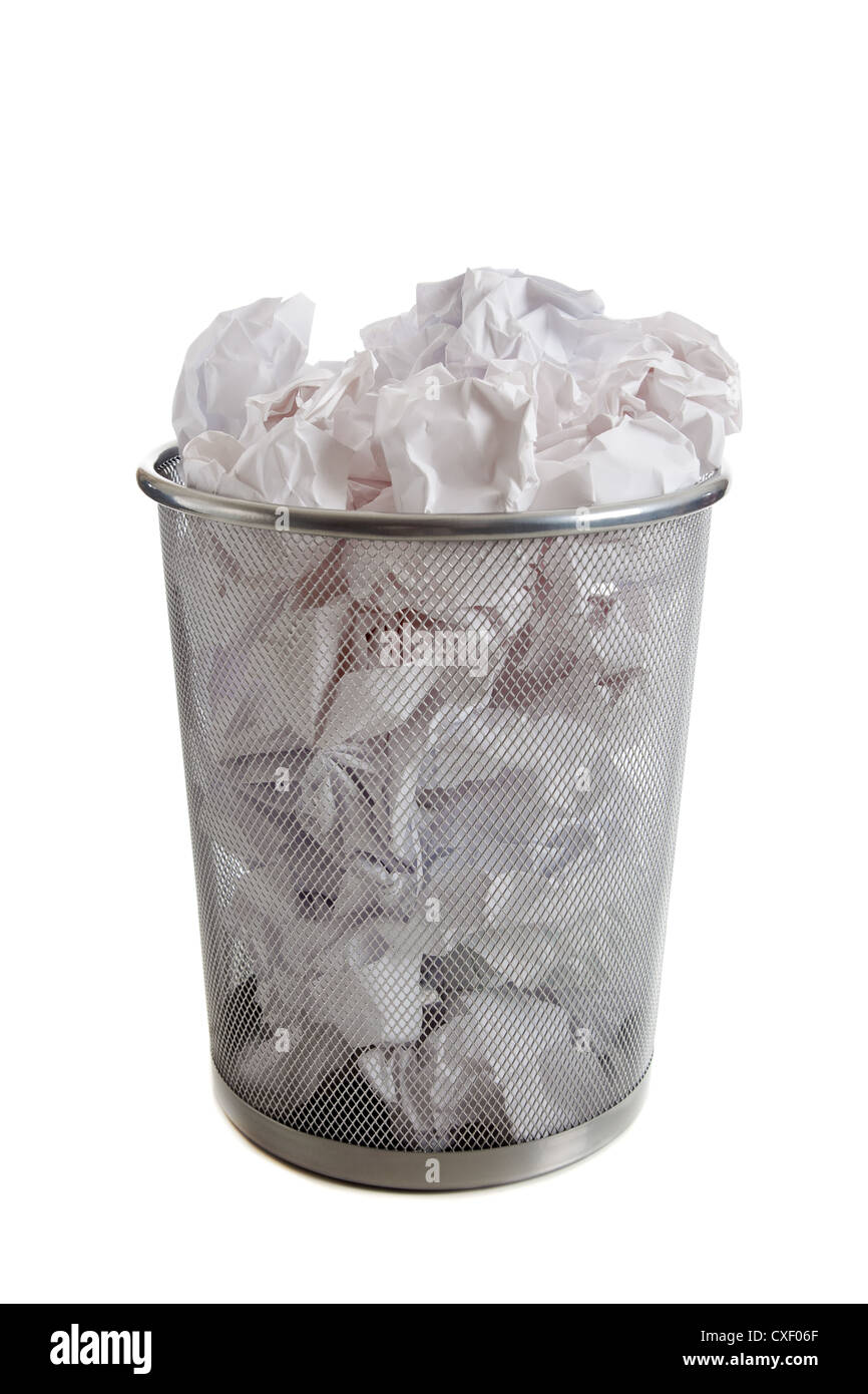 Wire mesh trashcan with crumpled paper in it - Stock Image