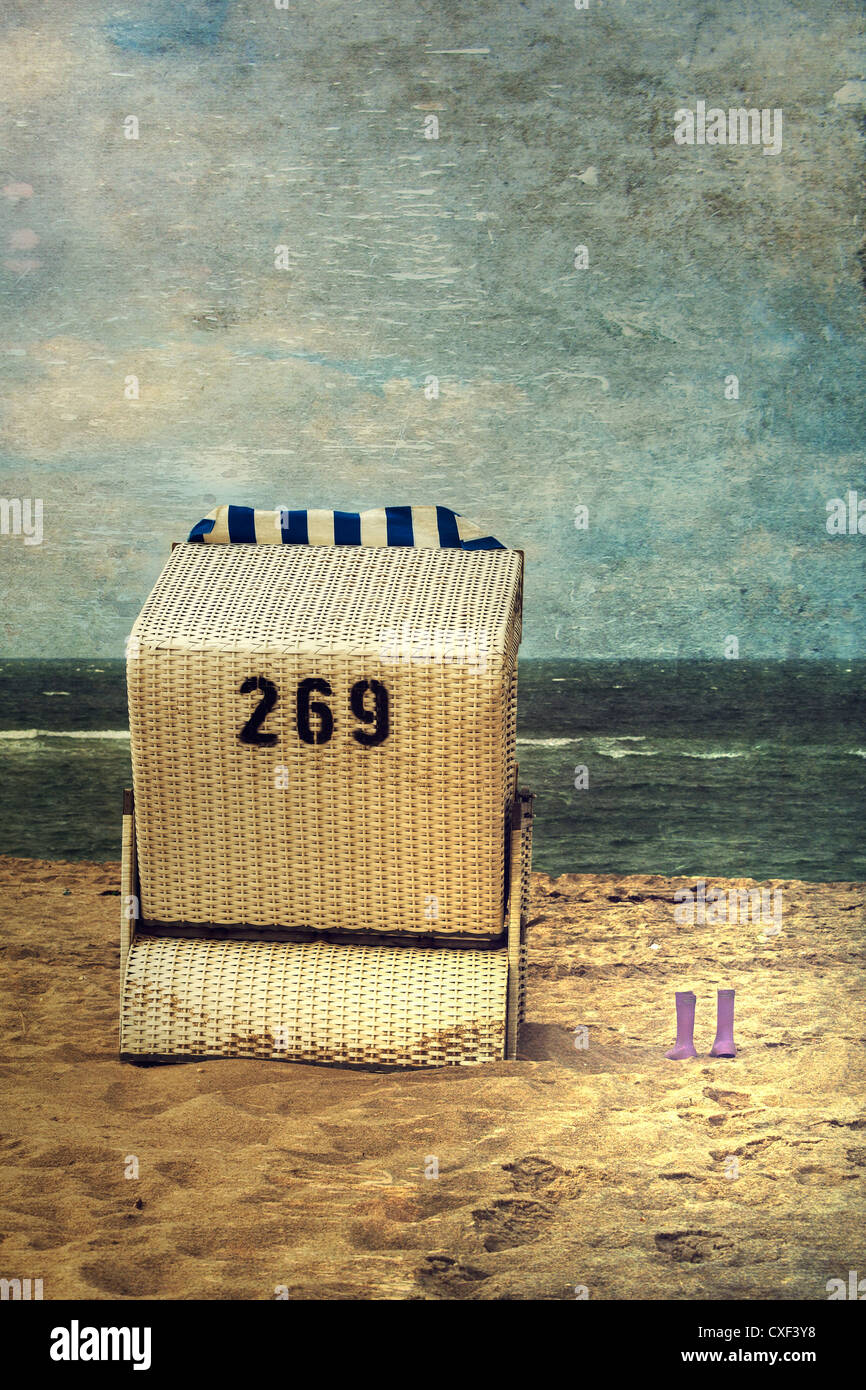 a beach chair with wellingtons - Stock Image