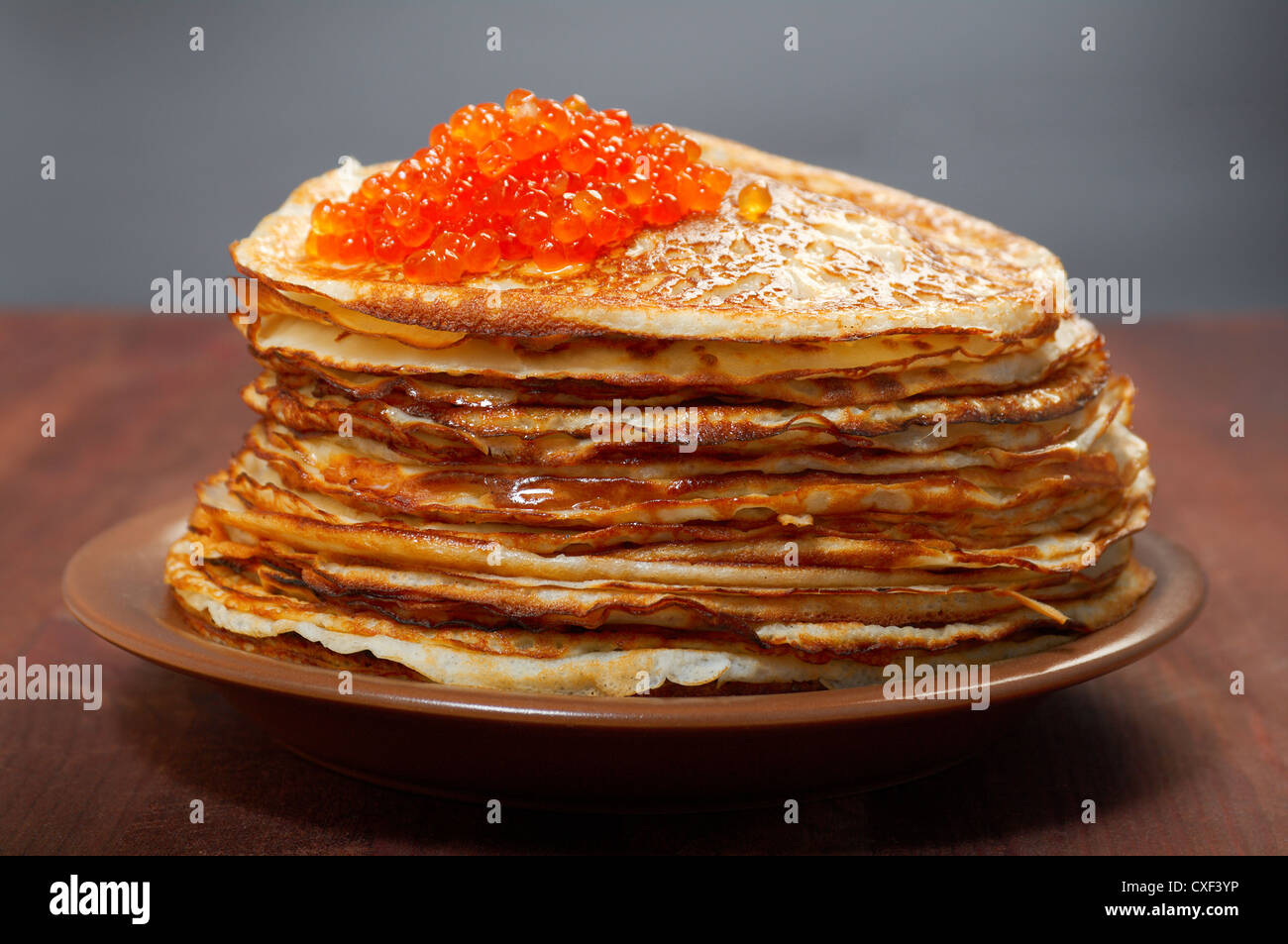 Russian pancakes  with red caviar - Stock Image