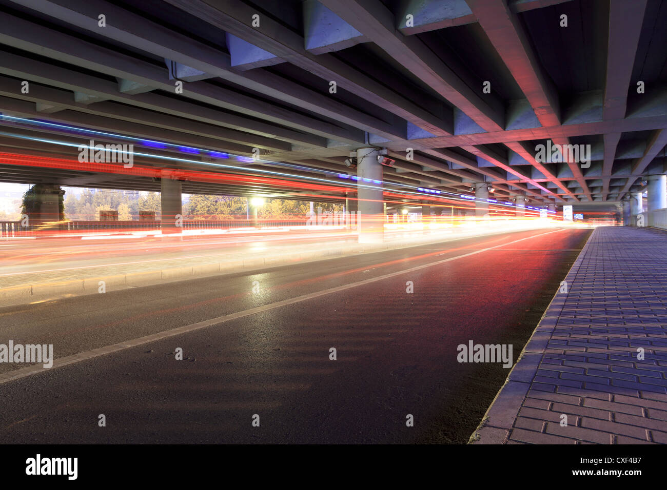 traffic under the viaduct - Stock Image