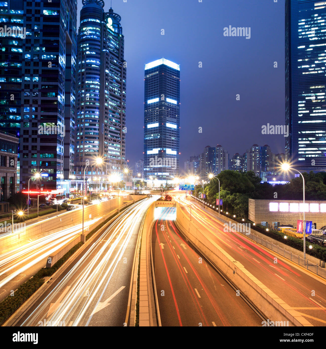 light trails on shanghai financial center at night - Stock Image