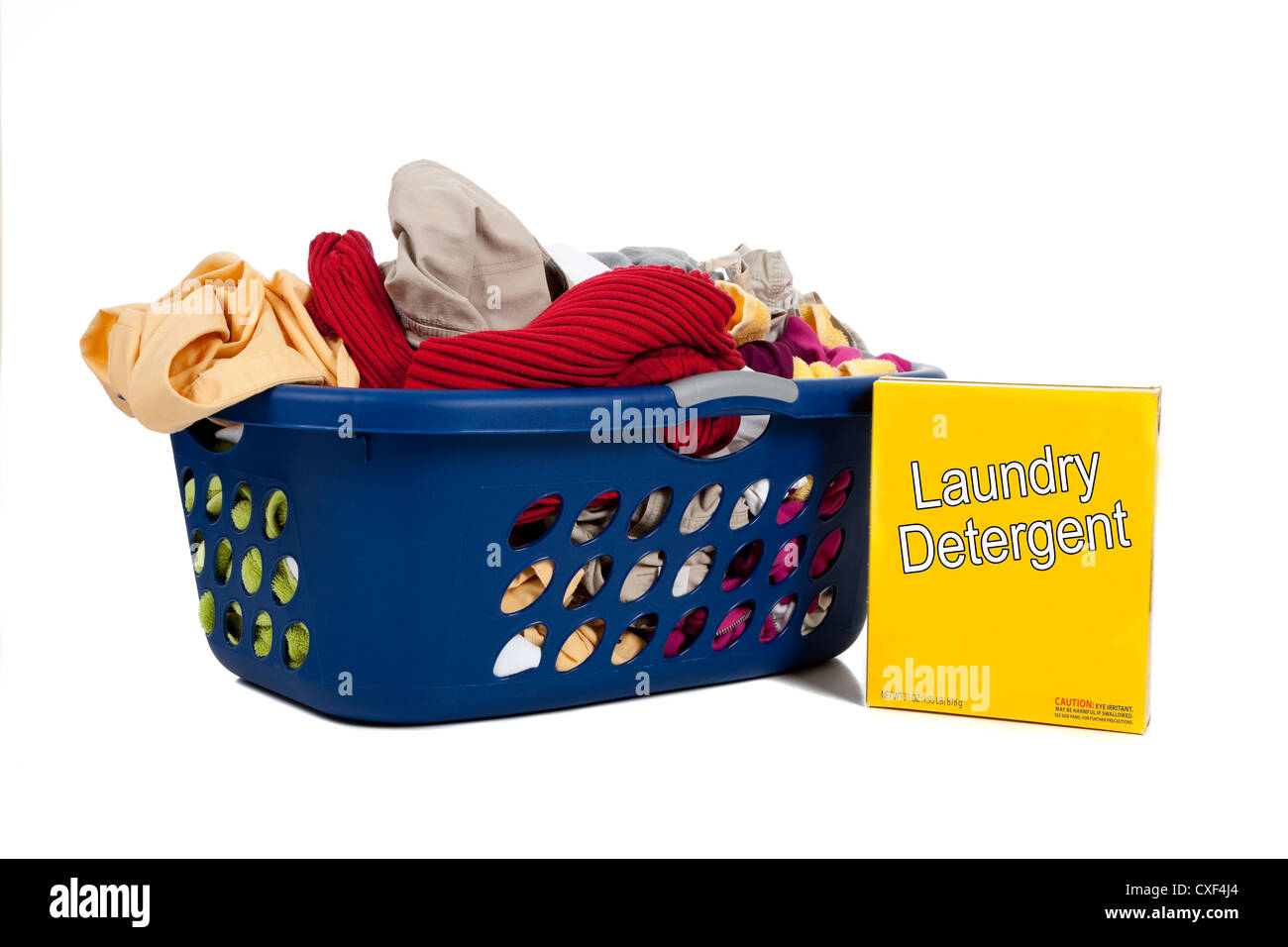 blue laundry basket with dirty clothes and a  box of yellow laundry detergent - Stock Image