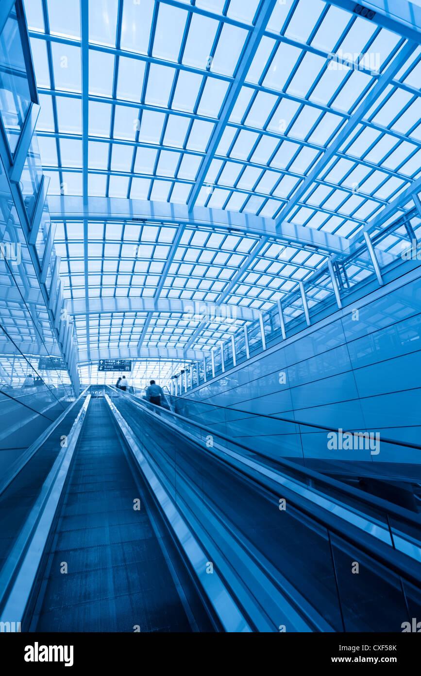 escalator in modern interior airport - Stock Image