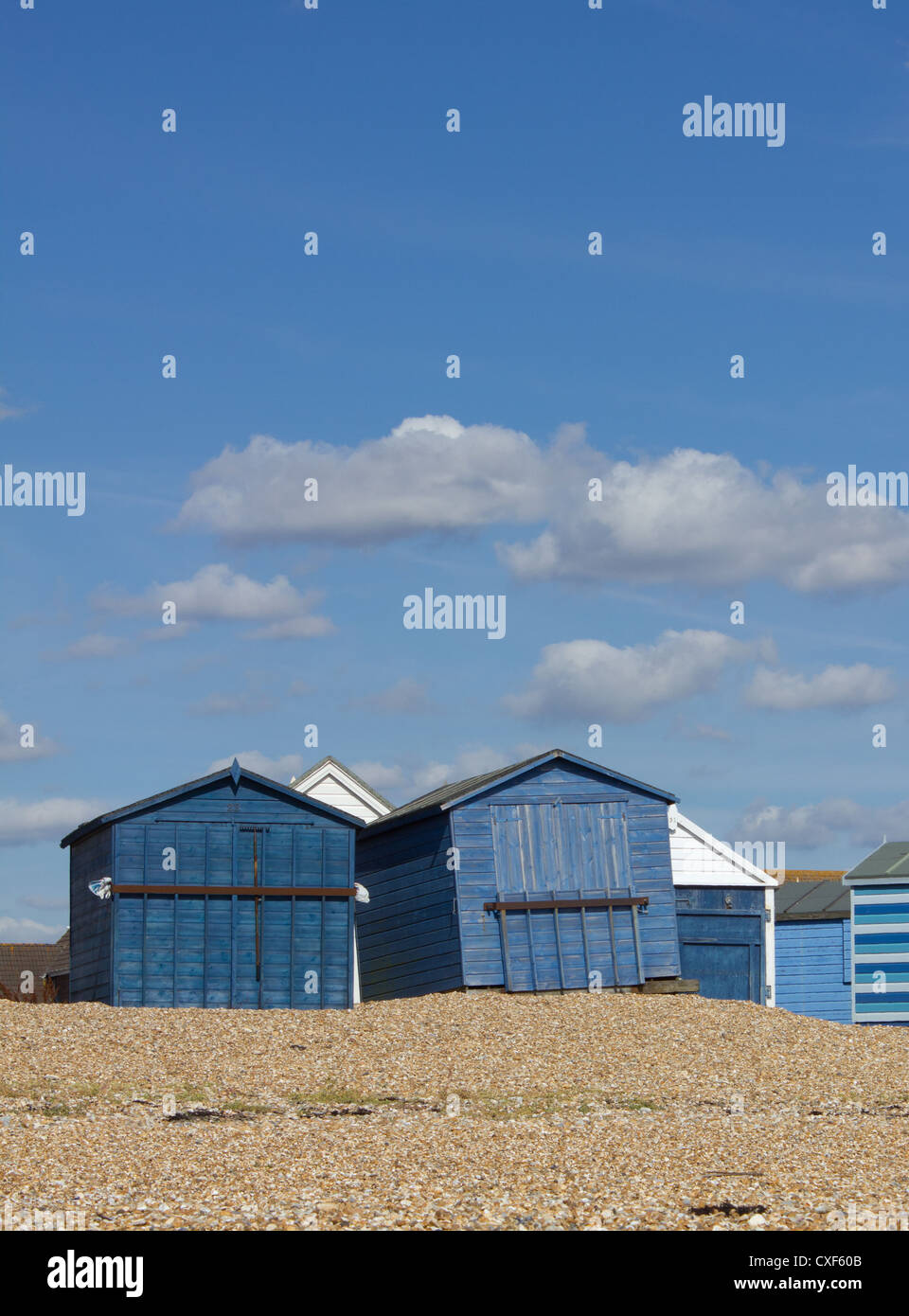Two blue beach huts one at a strange angle - Stock Image