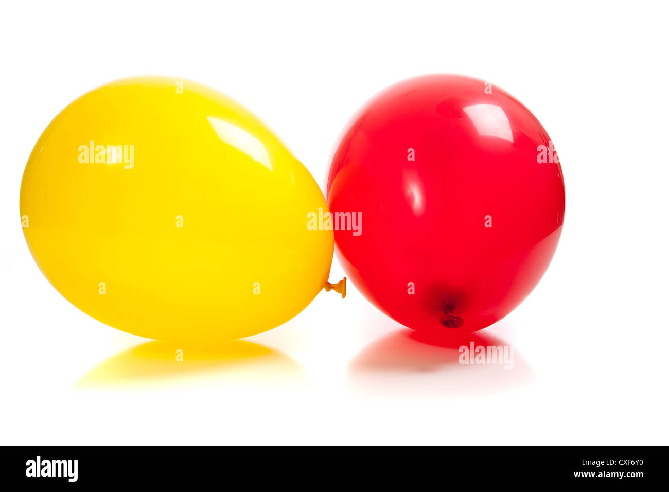 A red and yellow balloon on a white background - Stock Image