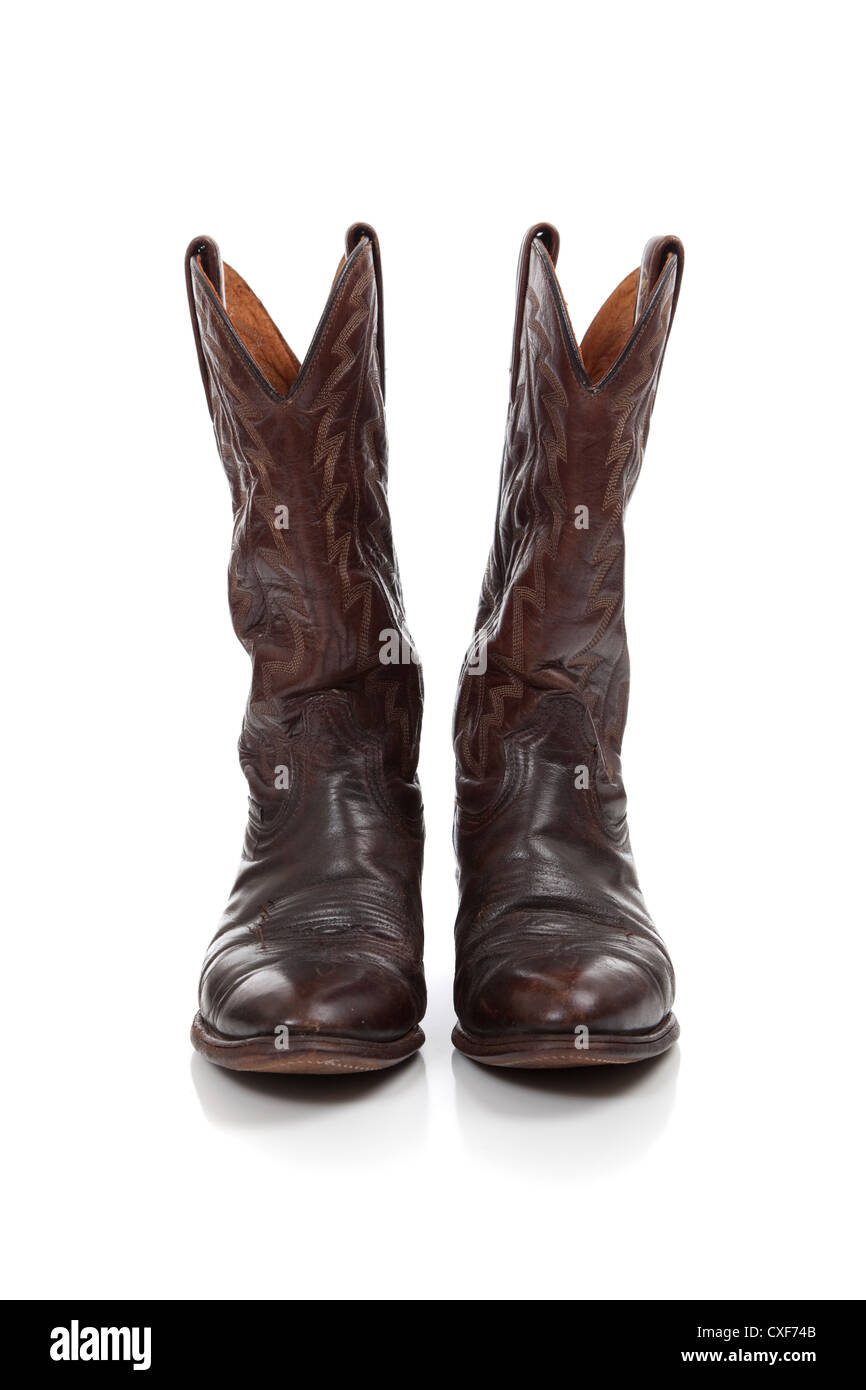 37da21d2684 Brown leather cowboy boots on a white background Stock Photo ...