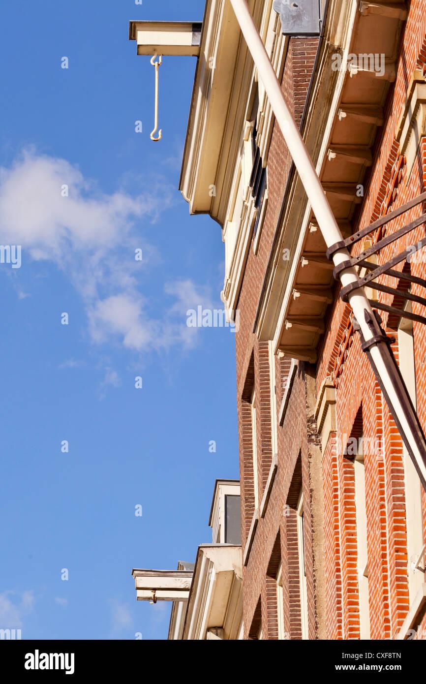Amsterdam: Hooks at building tops - Amsterdam, Netherlands, Europe - Stock Image