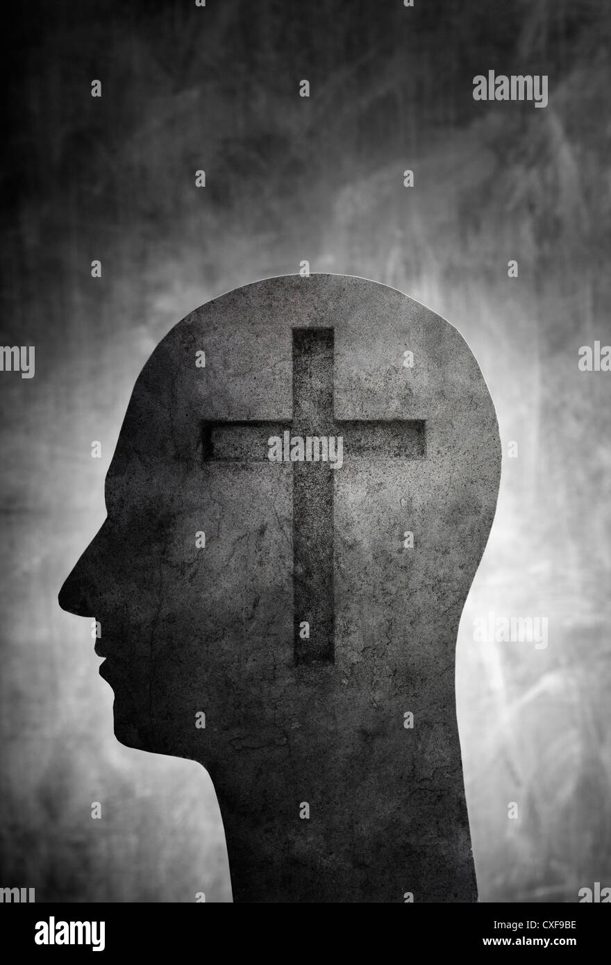 Conceptual image of a head with a christian cross symbol. - Stock Image