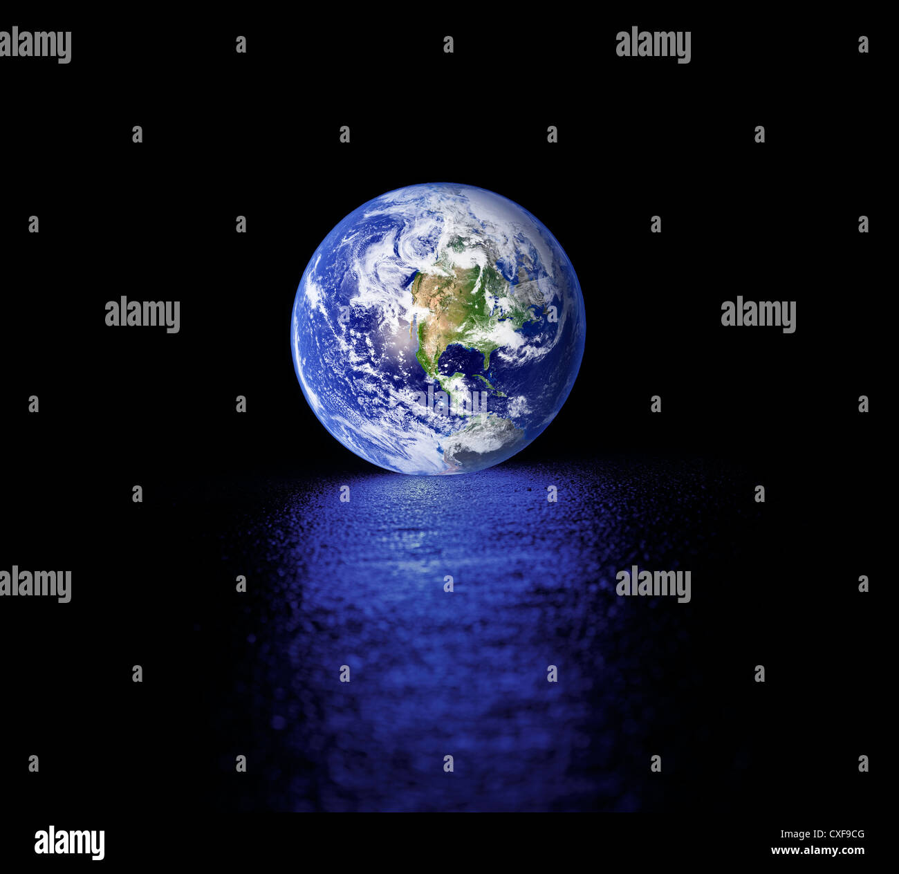 Glowing Planet earth on wet asphalt. Earth image provided by NASA. - Stock Image