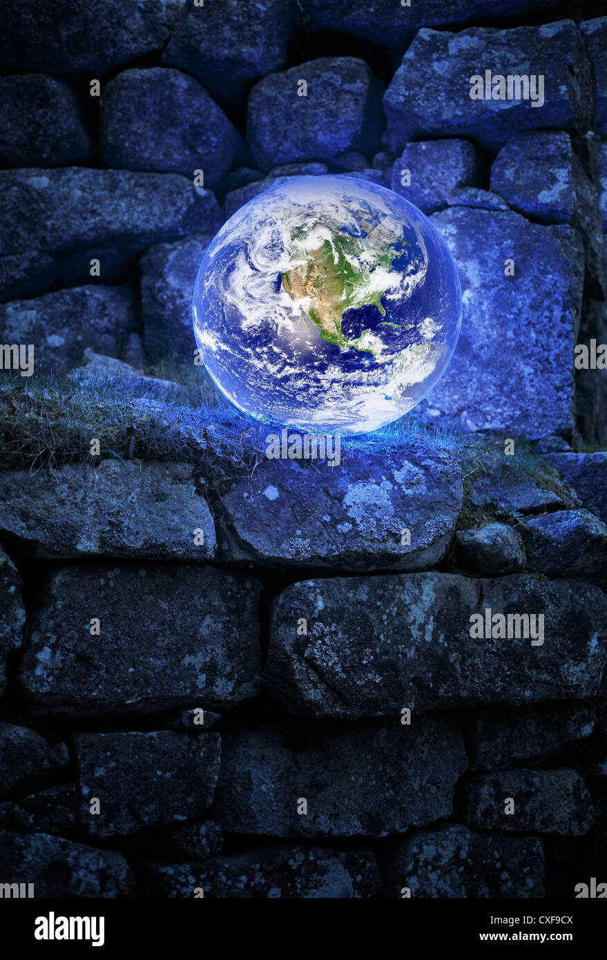 Planet earth on an old castle wall. Earth image provided by NASA. - Stock Image