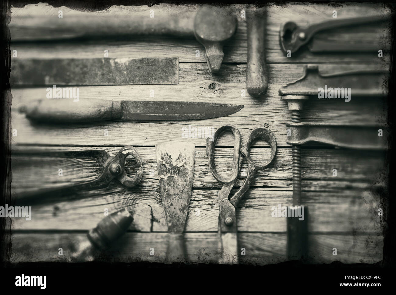 A collection of old rusty tools with grunge borders. - Stock Image