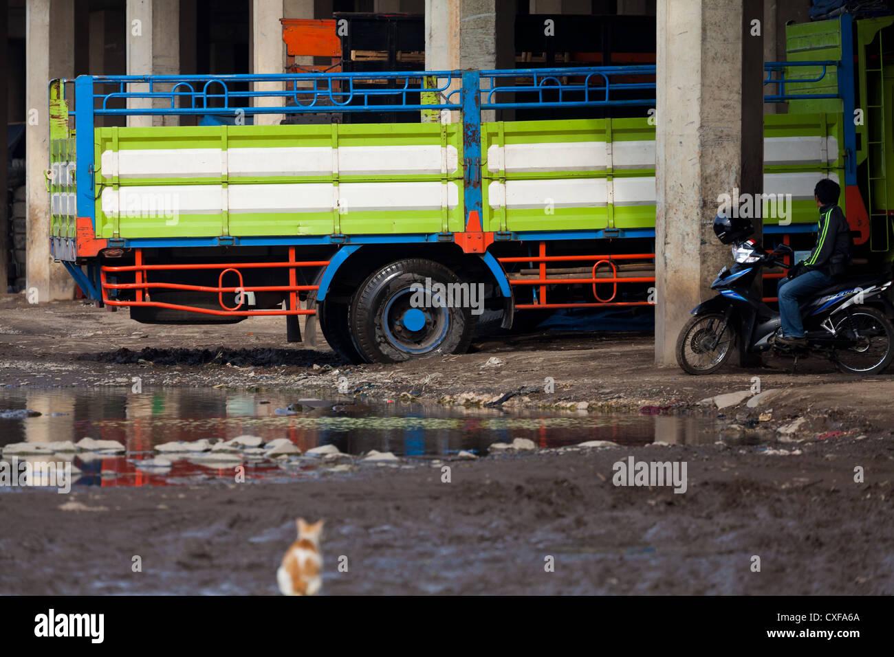 Truck in a poor Area in Jakarta Stock Photo