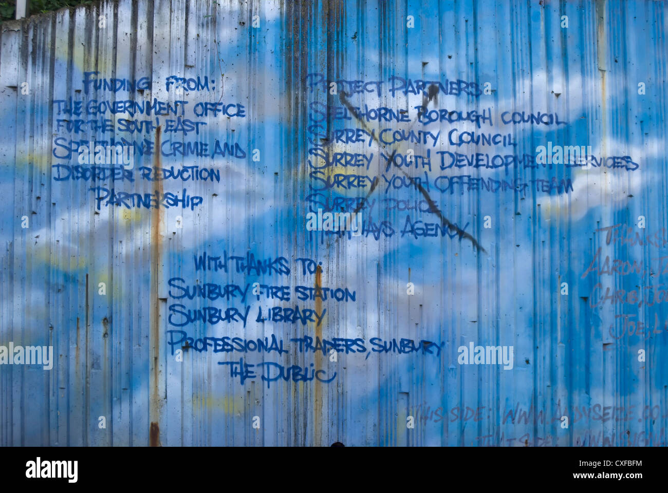 sponsor credits for graffiti at sunbury cross subway, middlesex, england - Stock Image