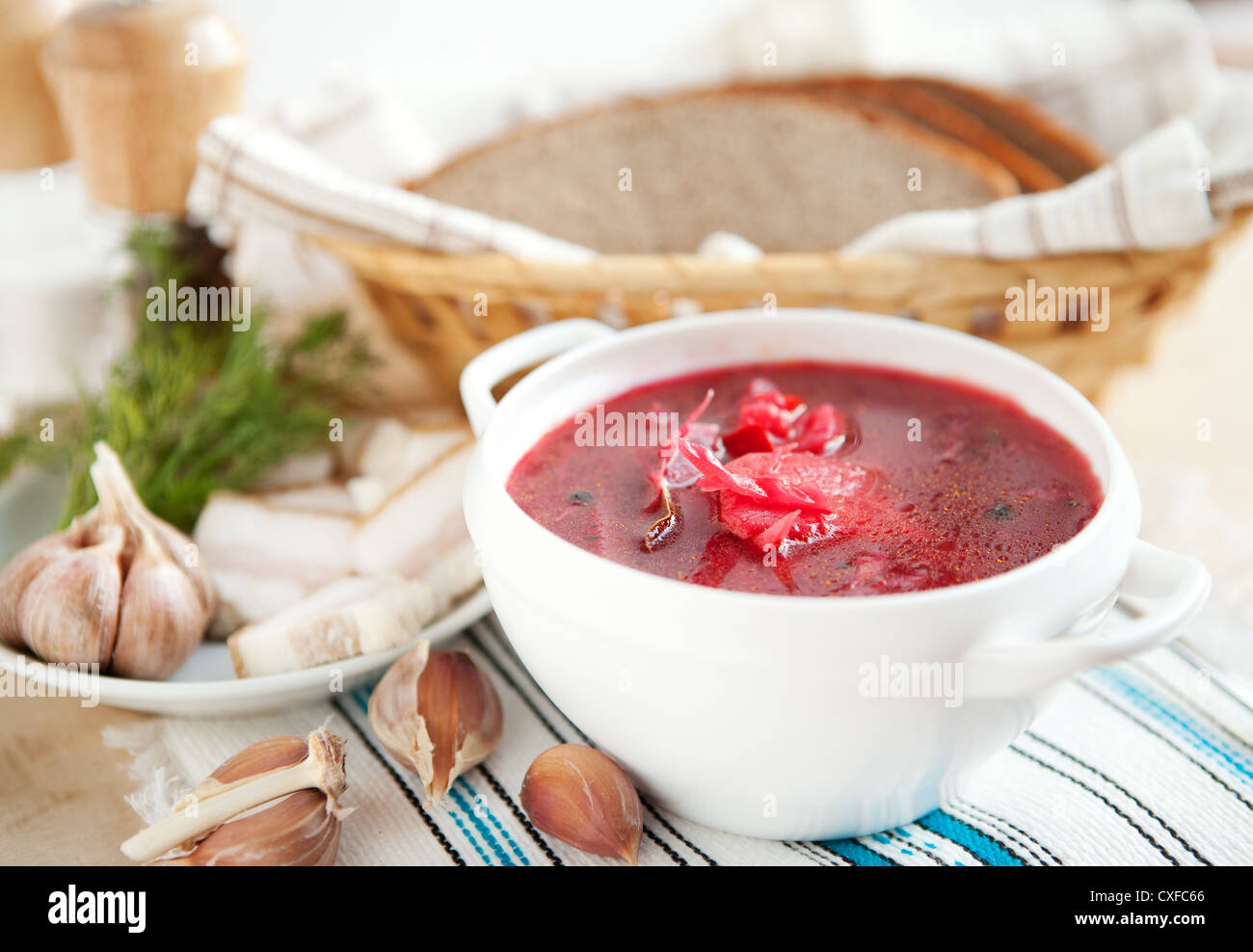 Red borscht without meat in a white bowl. soup Stock Photo