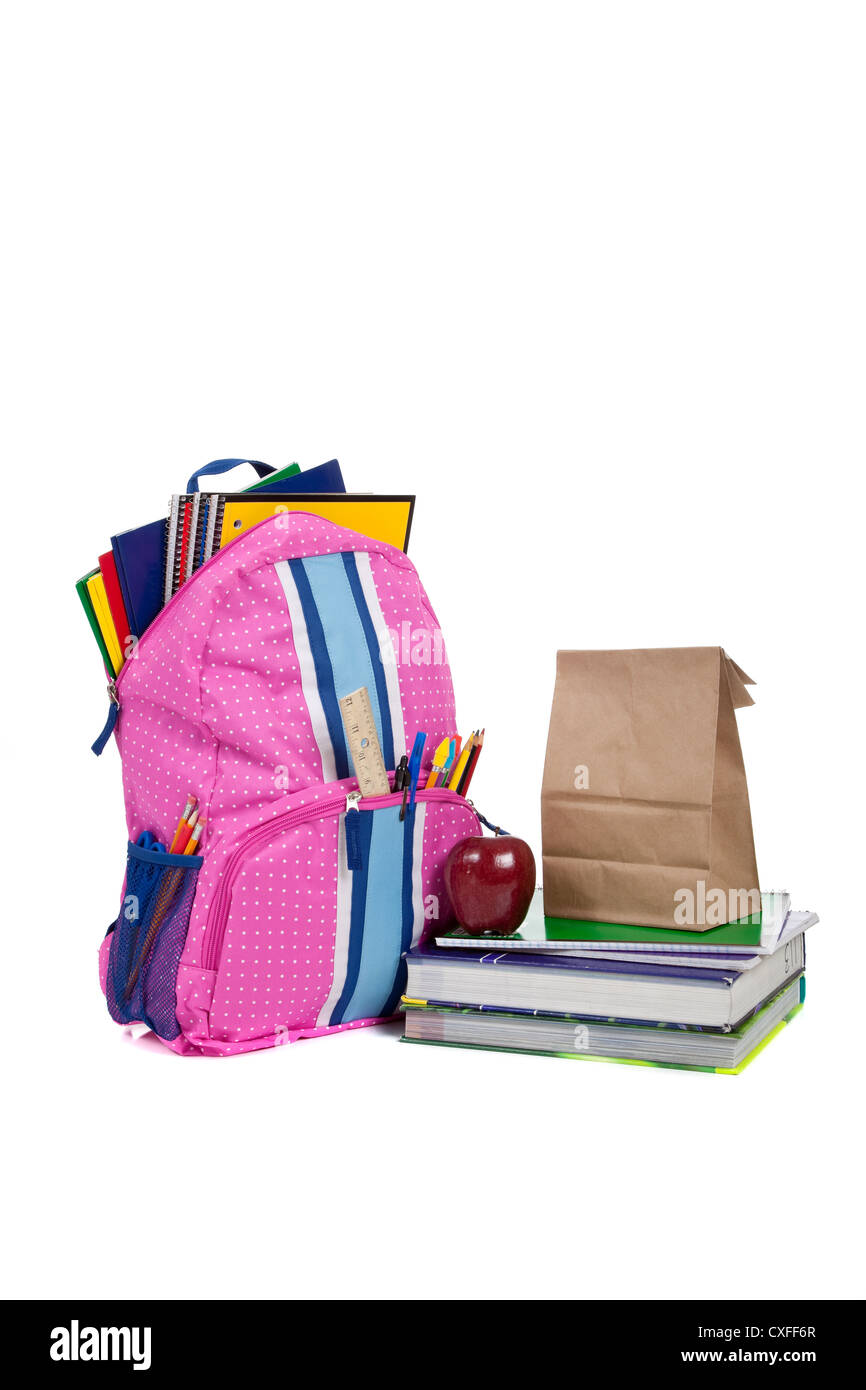 Pink bookbag with school supplies and lunch - Stock Image