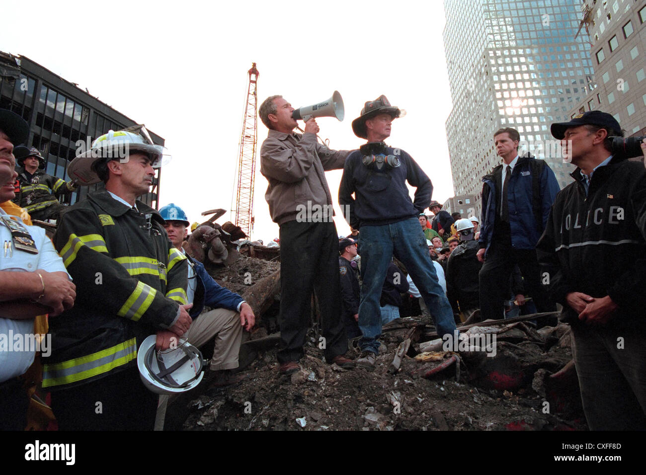 US President George W. Bush standing atop rubble from the destroyed World Trade Center addresses rescue workers - Stock Image