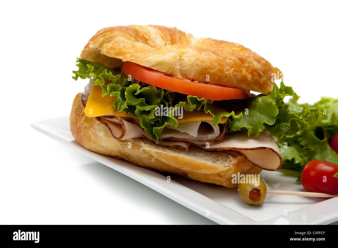 Ham sandwich on a croissant - Stock Image