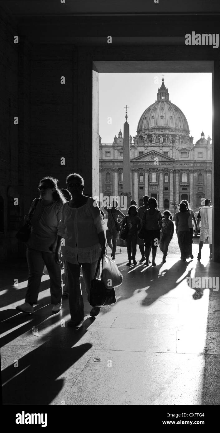 tourists framed in front St Peters Basilica, Vatican, Rome. Stock Photo