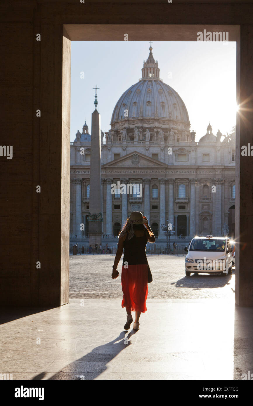 woman framed in front St Peters Basilica, Vatican, Rome. Stock Photo