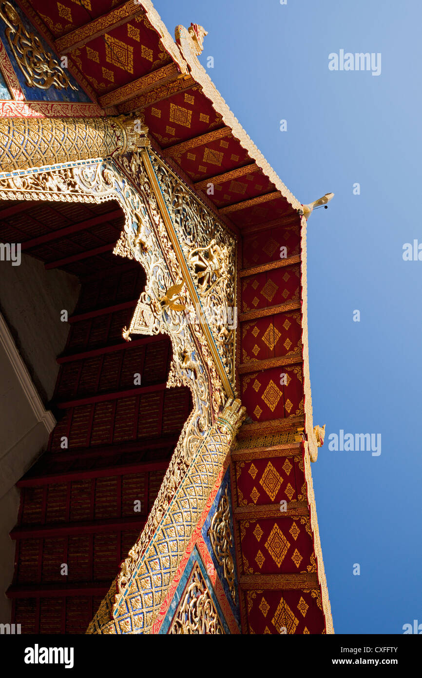 Carved woodwork above entrance to Wihaan (Ordination Hall), Wat Phra Singh, Chiang Mai, Thailand - Stock Image