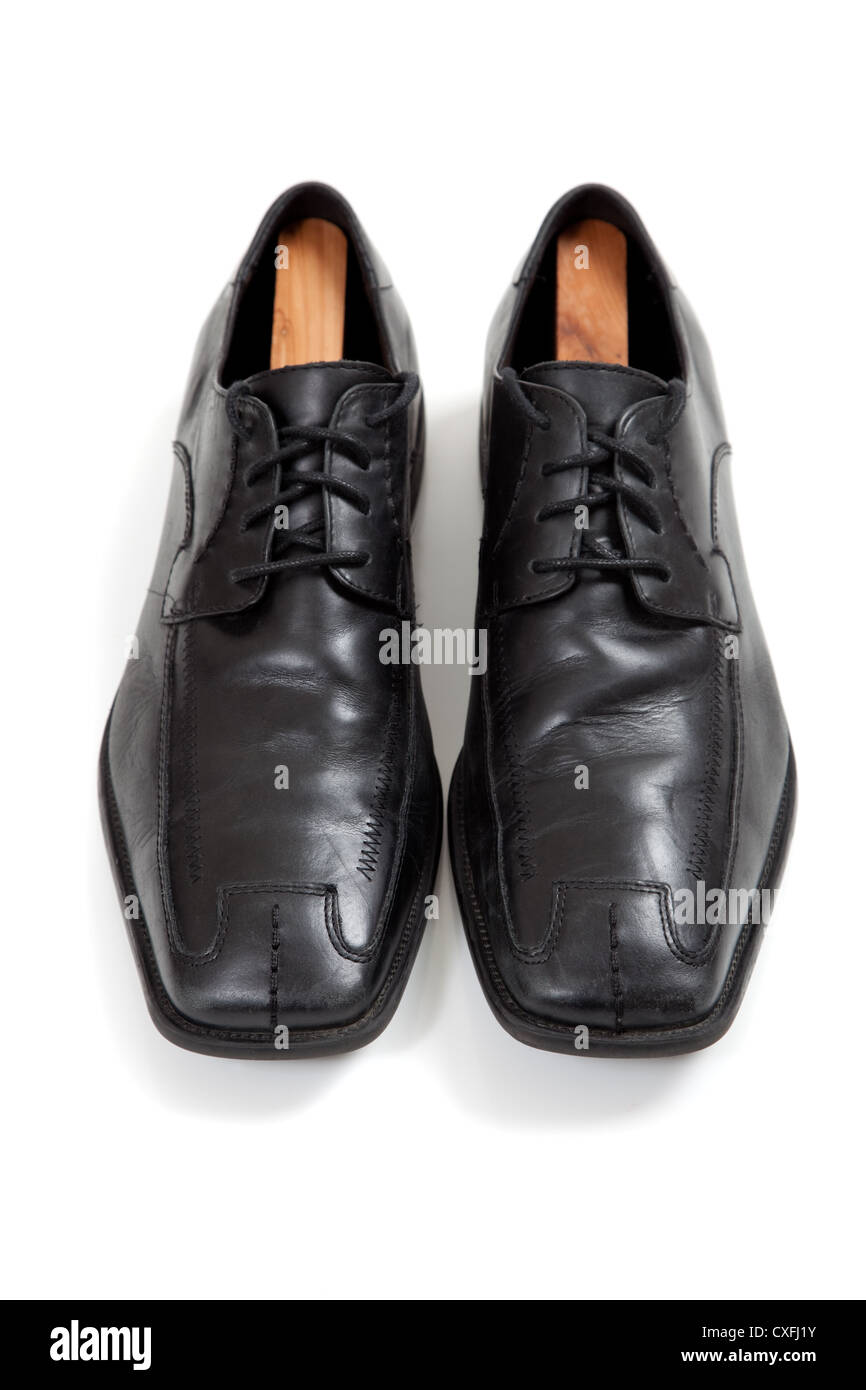 2cee64001e79 A Pair of men s black leather dress shoes on a white background ...