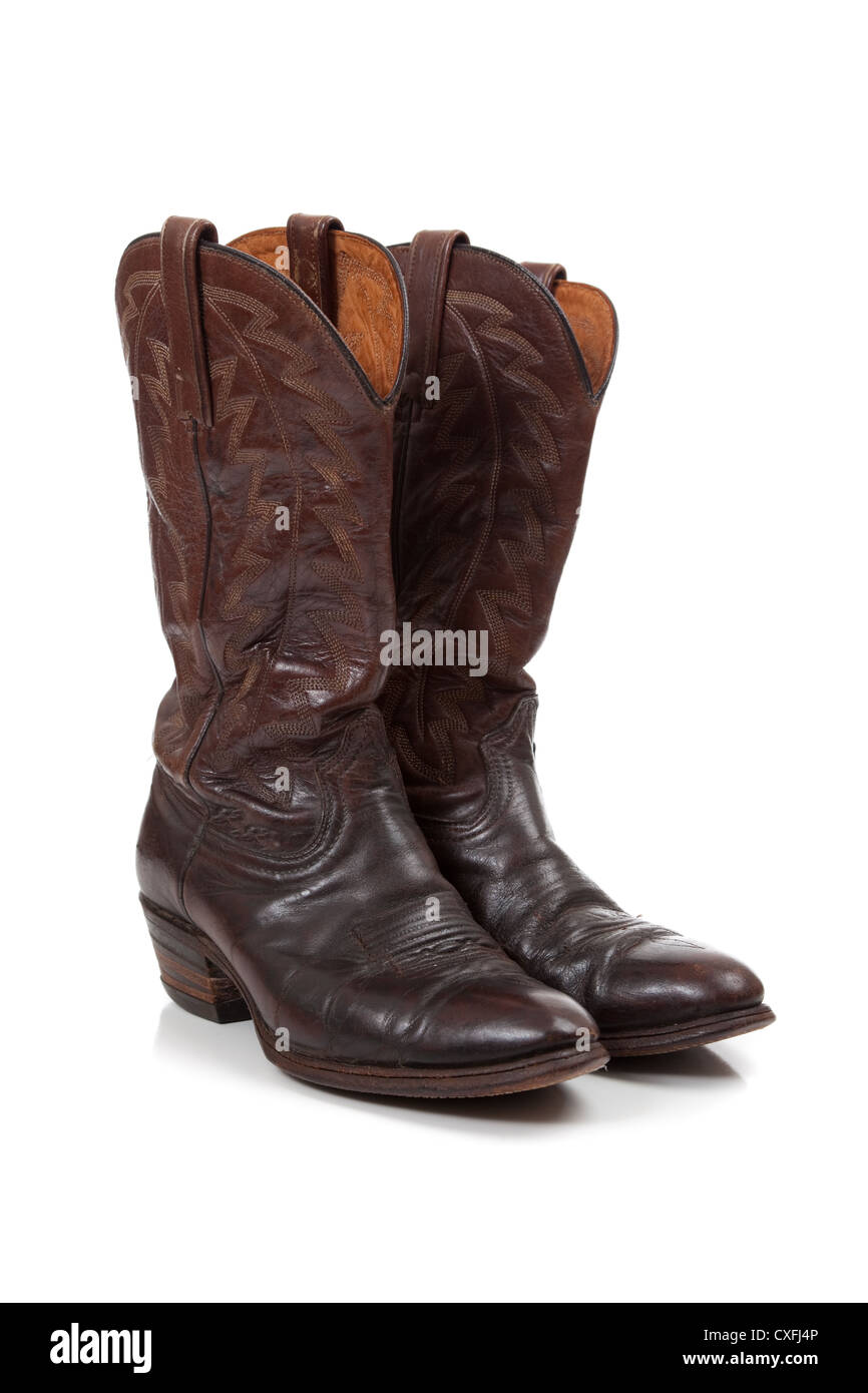 2a9ce30b144 a Pair of worn leather cowboy boots on a white background Stock ...