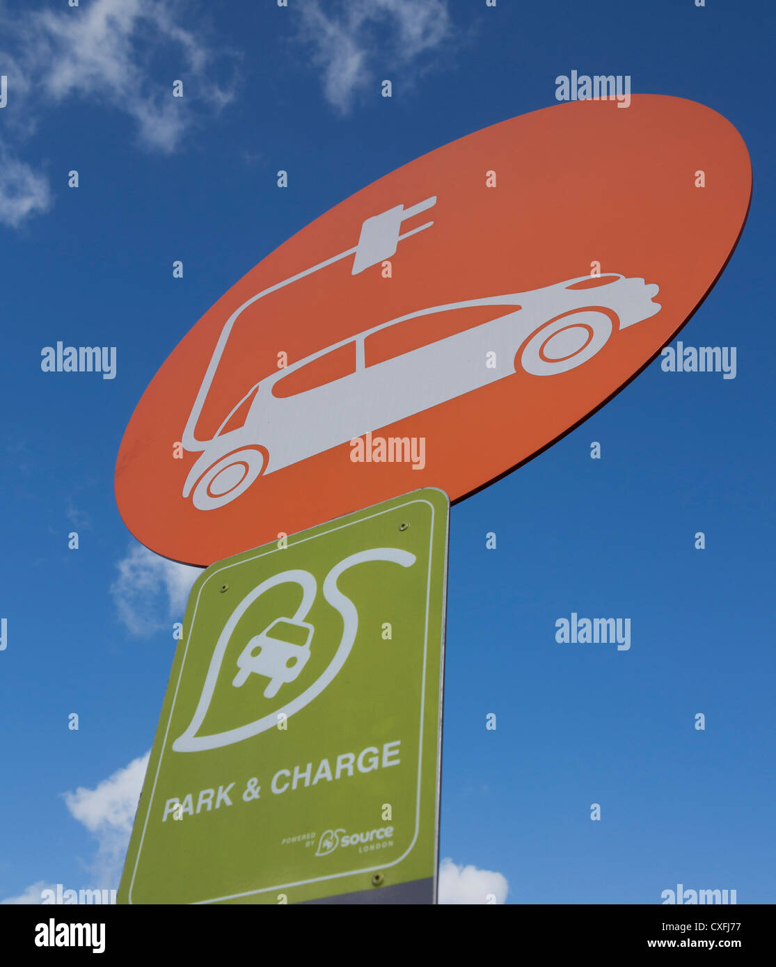 Park and charge new environmental green scheme for electric cars at supermarket car park in the UK - Stock Image