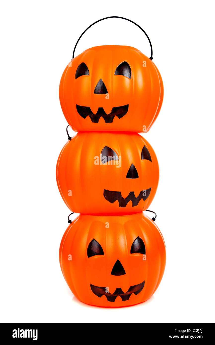 Stack of orange jack-o-lantern on a white background Stock Photo