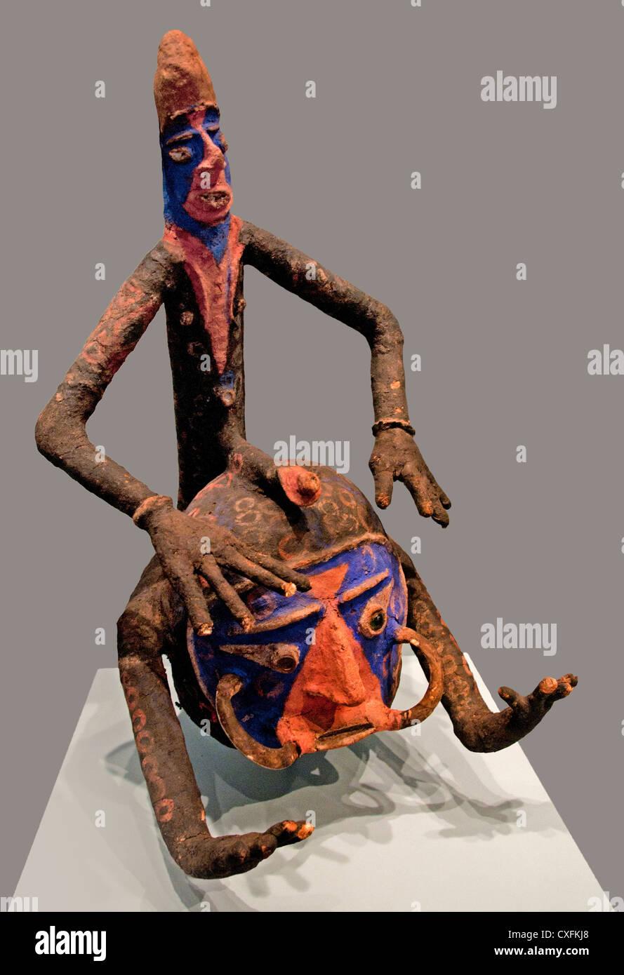 Helmet Mask Temes Mbalmbal mid-20th century  Vanuatu Southwest Malakula  Wood vegetable fiber pig tusks glass metal - Stock Image