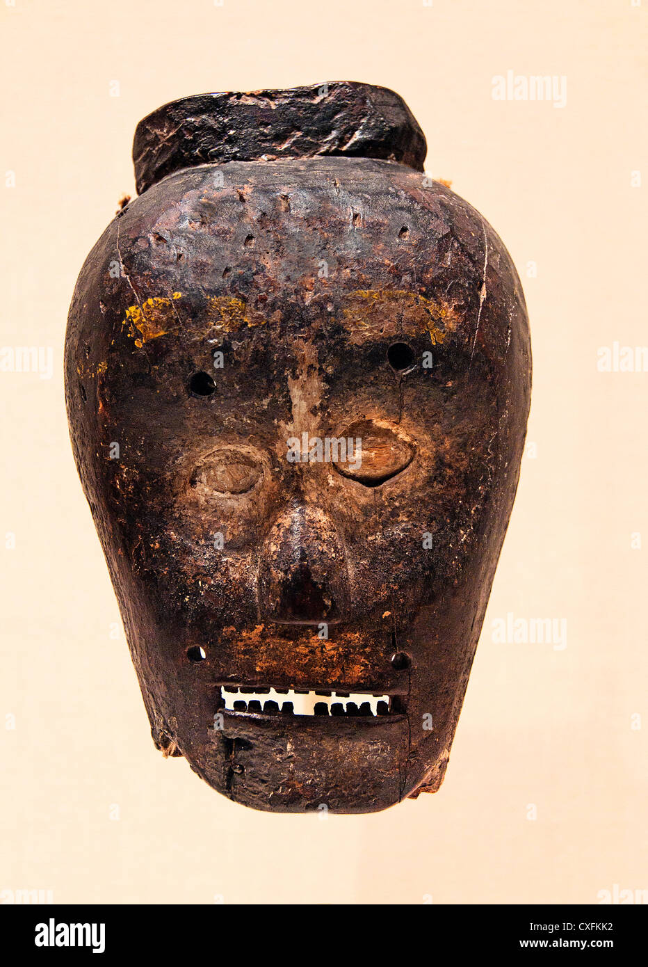 Mask 19th century  Republic of Timor Leste Culture East Timor Wood fiber pain, lime hair 22.9 cm Stock Photo