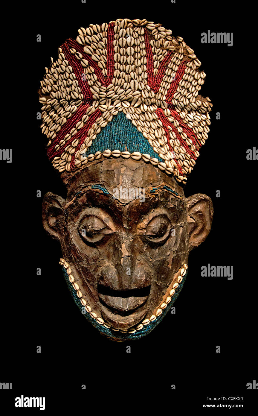 Helmet Mask before 1880 Cameroon Grassfields Bamum kingdom Medium: Wood copper glassbeads raffia cowrie shells 66cm - Stock Image