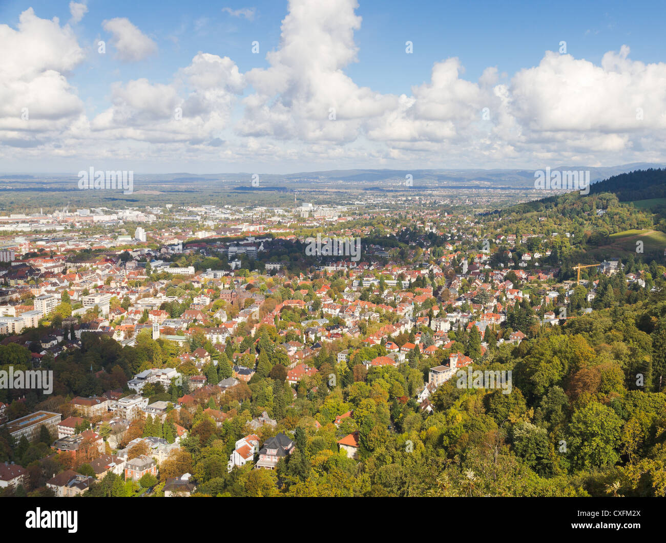 Panorma aerial view over town Freiburg im Breisgau in green valley, Germany Stock Photo