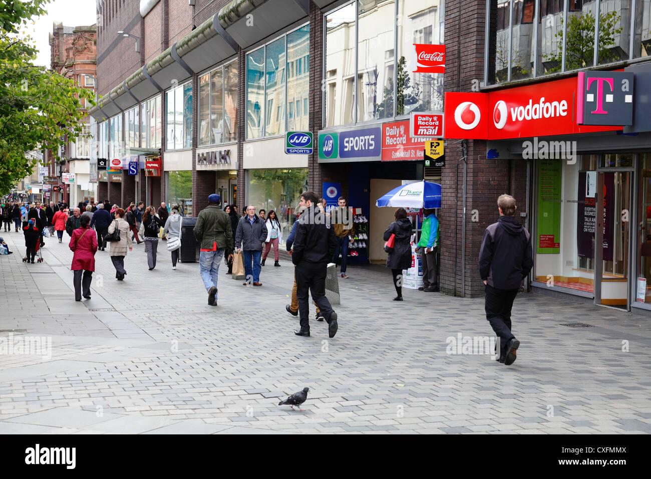 Pedestrians in Sauchiehall Street shopping precinct in Glasgow City Centre, Scotland, UK - Stock Image