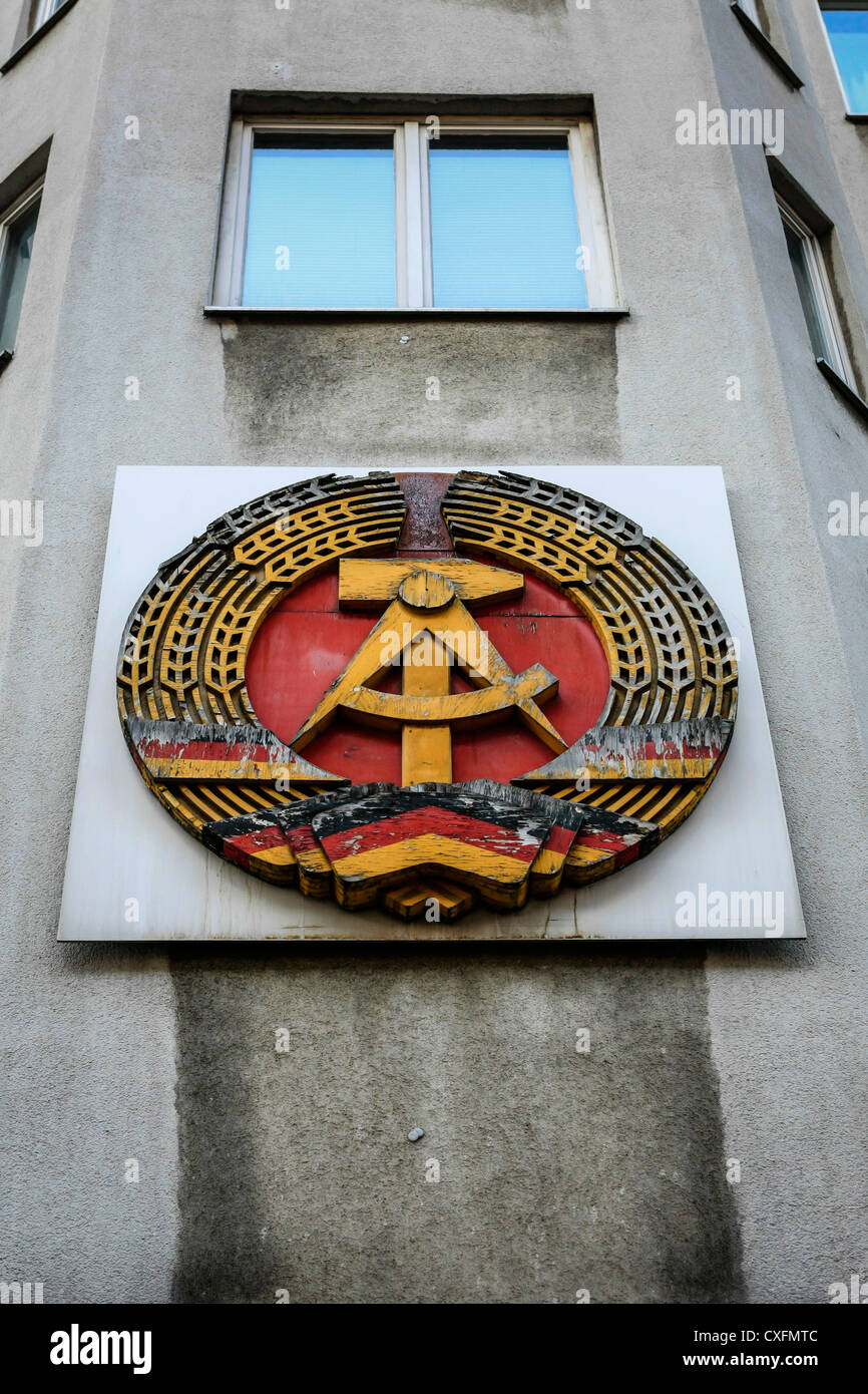 German Democratic Republic DDR Logo on display near Checkpoint Charlie in Berlin - Stock Image