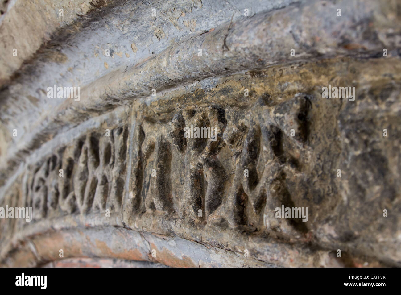 Latin stone inscription above fireplace at the medieval Welsh hall house, Neuadd Hafoty, Isle of Anglesey. - Stock Image