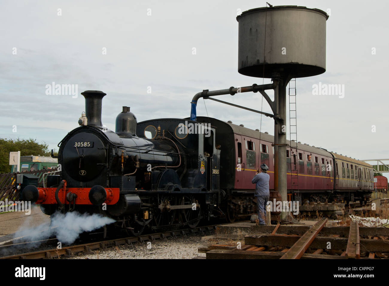 Steam Locomotive at Buckinghamshire Railway Centre, Quainton, taking on water before giving visitors a trip. - Stock Image