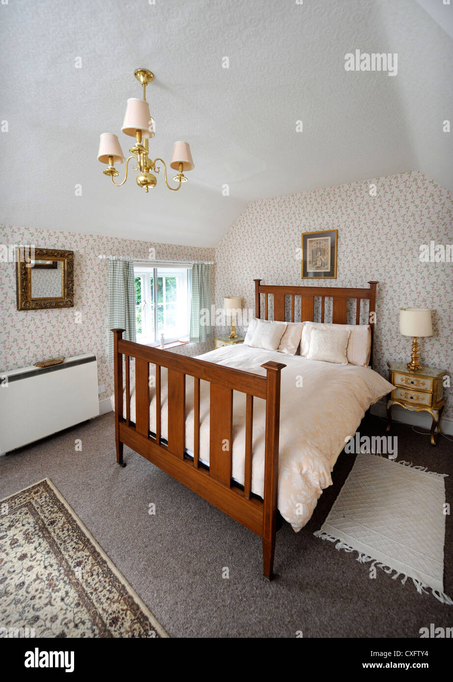 Small double bedroom in a holiday let Herefordshire UK Stock Photo on fitness packages, software packages, catering packages, bath packages, marketing packages,