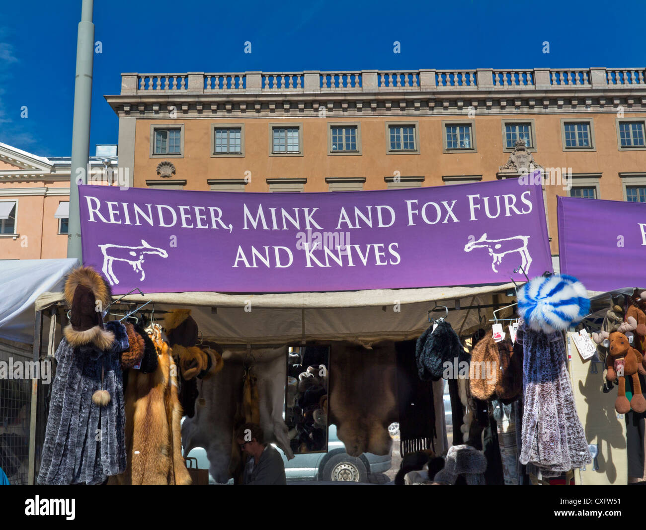 Controversial sign on Helsinki harbour market stall promoting mink, fox ,reindeer furs and knives! Finland - Stock Image