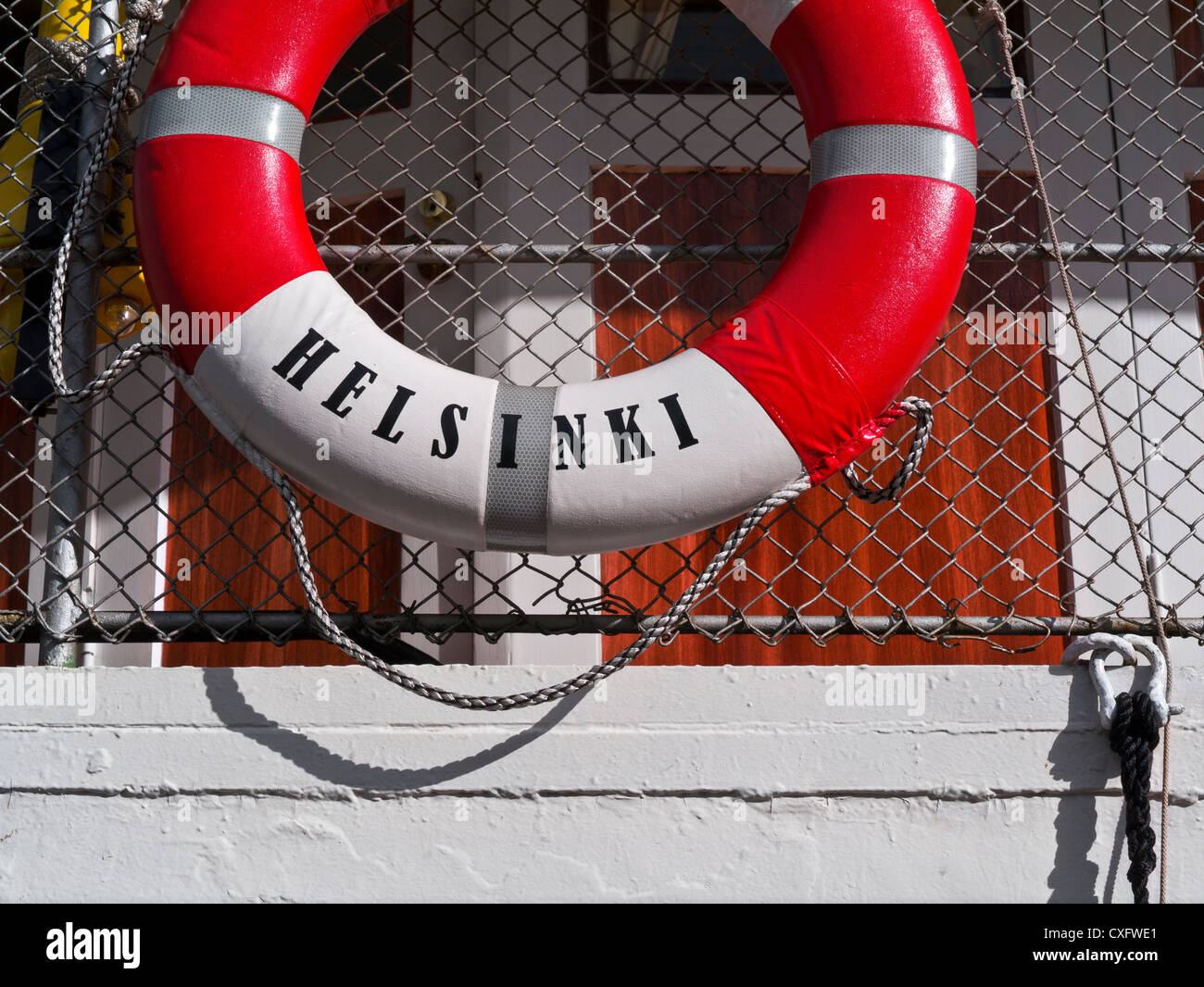 Lifebelt on tourist cruise boat named Helsinki in Helsinki Harbour Finland - Stock Image
