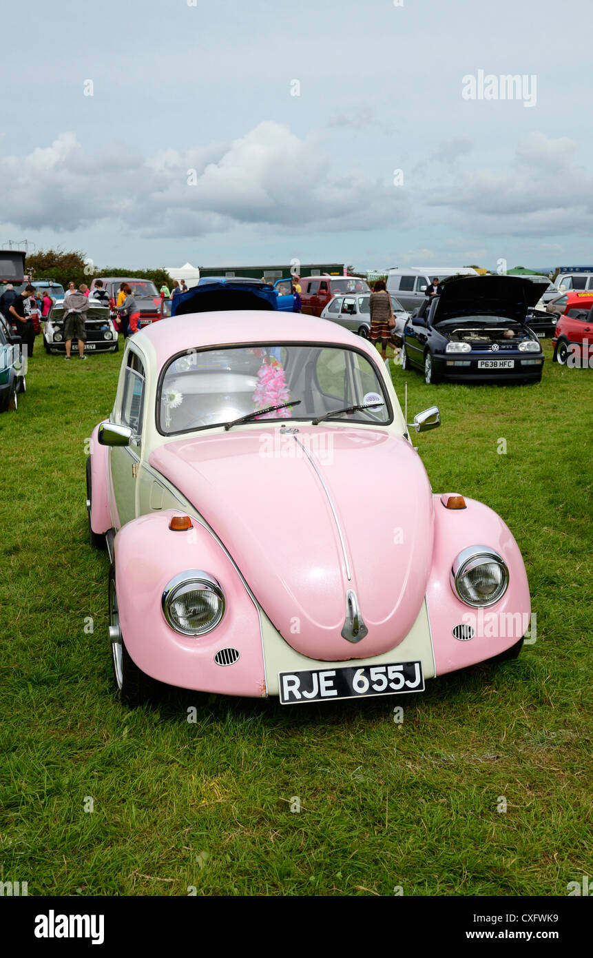 A pink Volkswagen Beetle at a rally in cornwall, uk Stock Photo