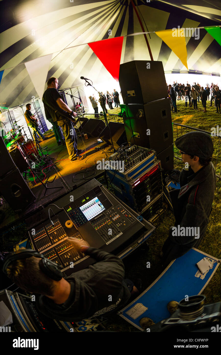 A view of the team working on the sound mixing desk at the side of the stage at a music festival, UK - Stock Image