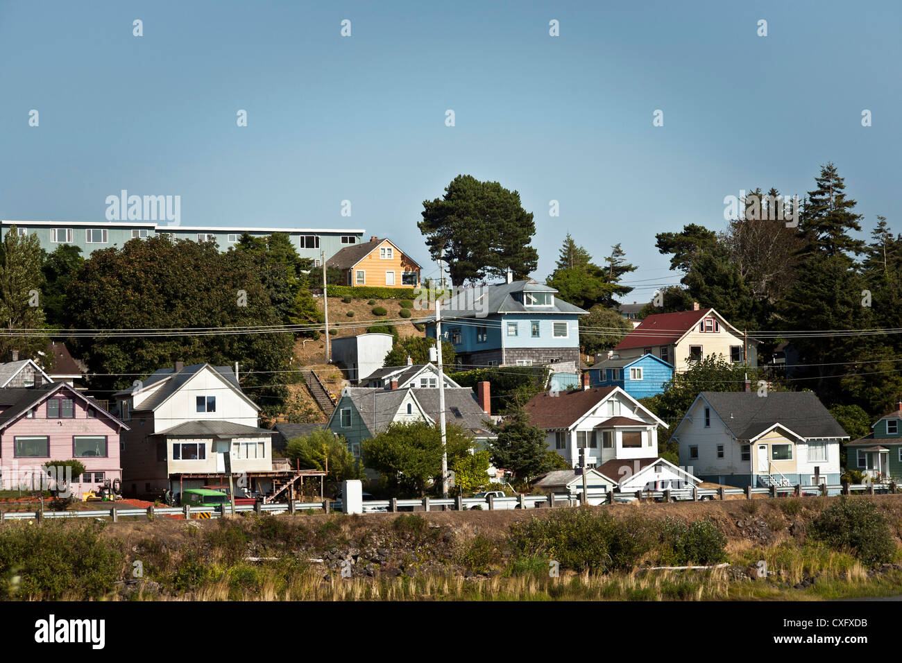 painted wood frame houses on hill overlooking Youngs Bay Astoria Oregon - Stock Image