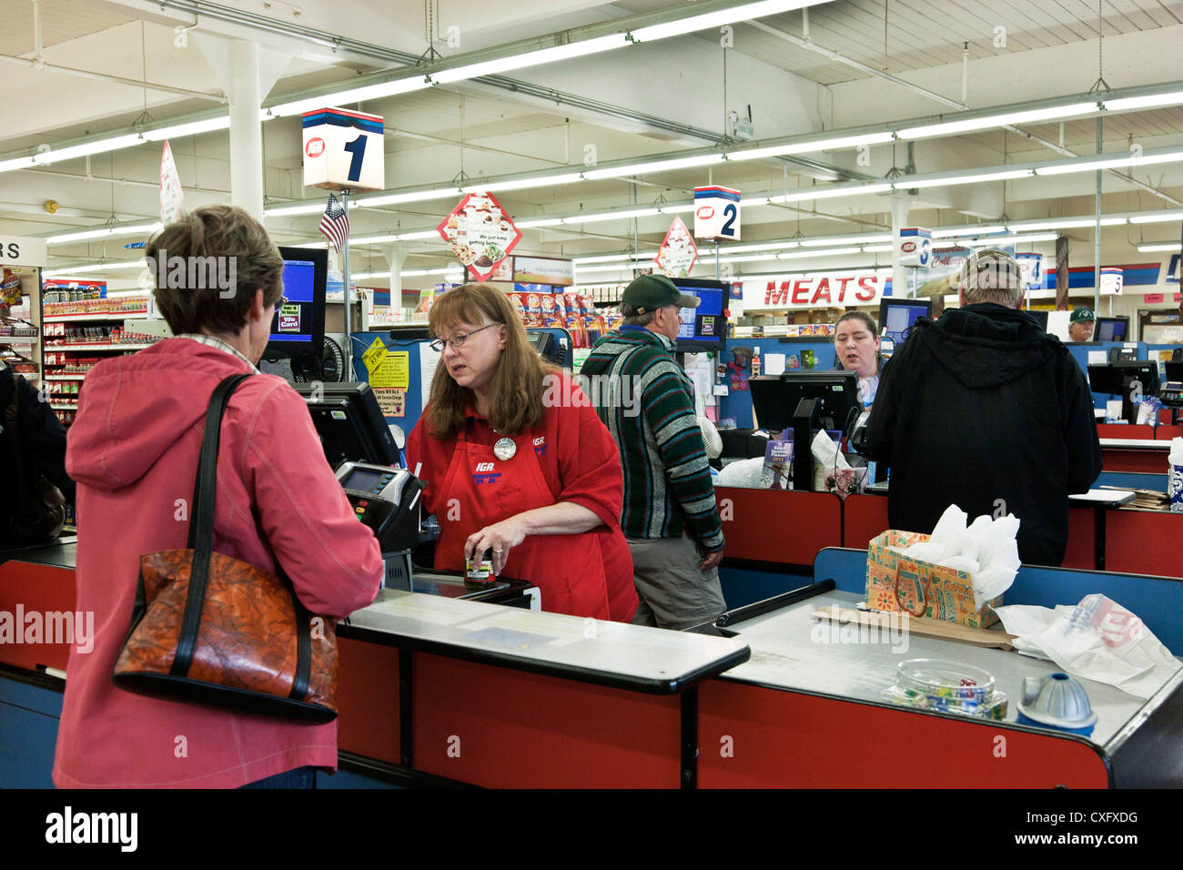 red white & blue themed check out lines at Sid's Supermarket grocery in small town of Long Beach Washington - Stock Image